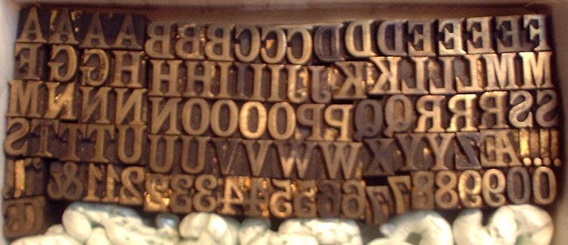 32 pt. roman brass type